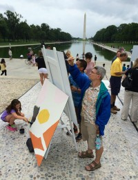 Painting by the Lincoln Memorial reflecting pool