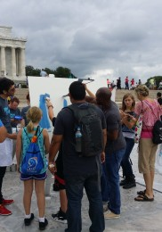 Tourists enjoy painting and the DC weather