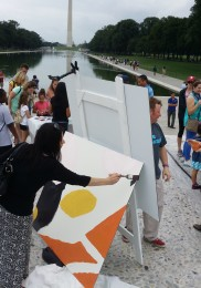 Painting by the reflecting pool
