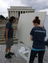 The #hopeforward team setting up a panel to be painted