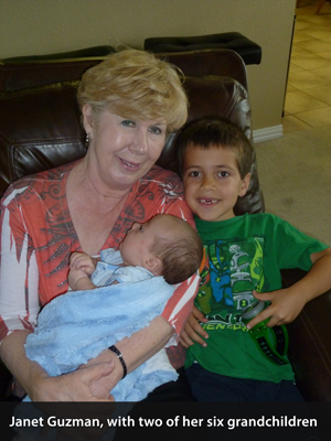 Janet Guzman with two of her six grandchildren
