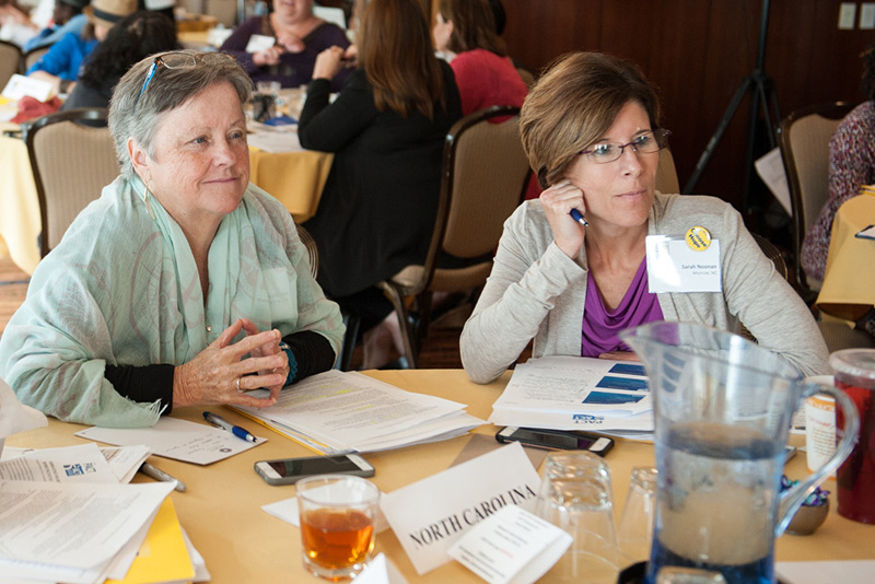 Sarah and friend Patsy listen during a workshop at the CPAT Symposium.