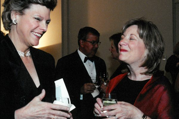 Cokie Roberts shares a laugh with longtime NCCS leader Ellen Stovall at the NCCS Ribbon of Hope Gala in 2002.